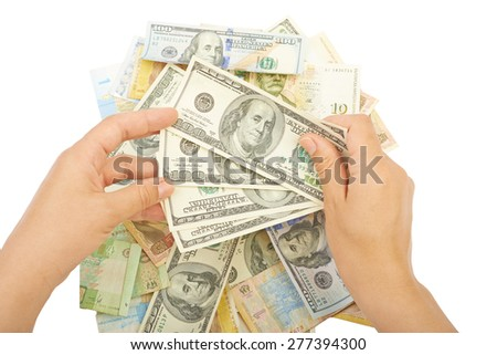 Background of various money in hand, currencies  - stock photo