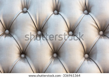 Background of Velvet / fabric modern sofa in close up. - stock photo