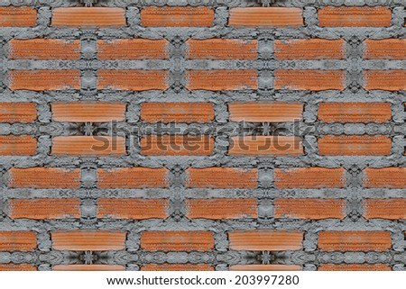 Background of wall of red bricks with cement  - stock photo