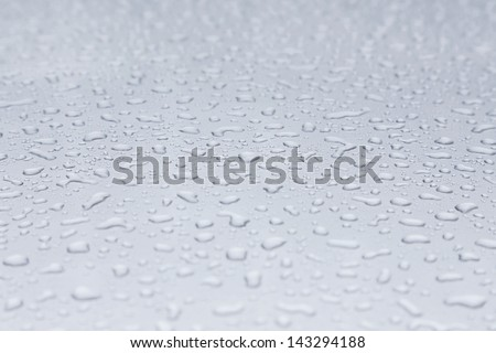 background of water drops on a car - stock photo