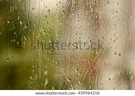 Background of water drops on the glass in the rain. - stock photo
