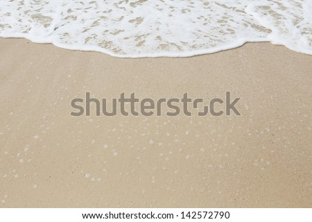 background of  wave on the sand - stock photo