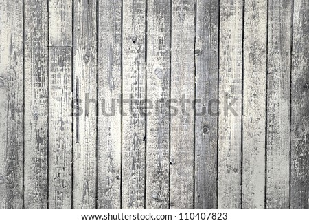 Background of weathered wood with peeling old white paint