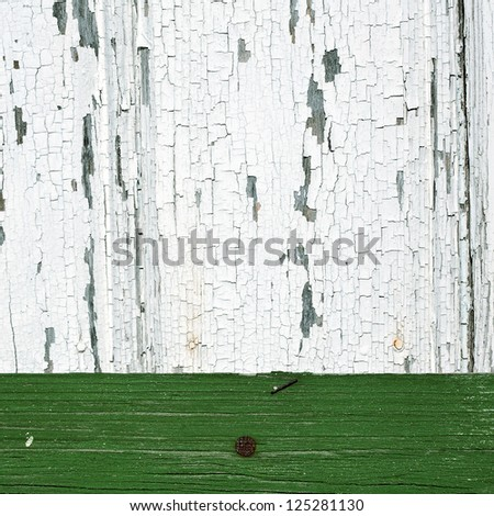 Background of white and green peeling paint on an old wall - stock photo