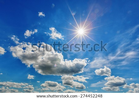 Background of white clouds with sun in blue sky - stock photo