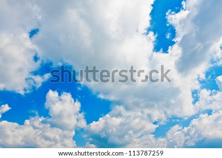 Background of white cumulus clouds in the blue sky