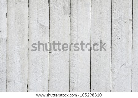 Background of white painted flaking wooden wall - stock photo
