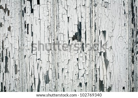 Background of white, peeling paint on an old wall - stock photo
