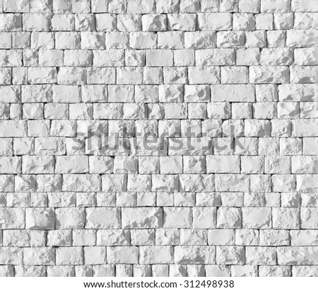 Background of white stone wall texture - stock photo