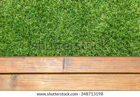 Background of wood and grass.
