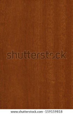 background of wood grain from Mahogany, the straight-grained, reddish-brown timber of three tropical hardwood species of the genus Swietenia, part of the chinaberry family, Meliaceae - stock photo