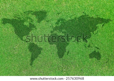 background of world map on green grass field
