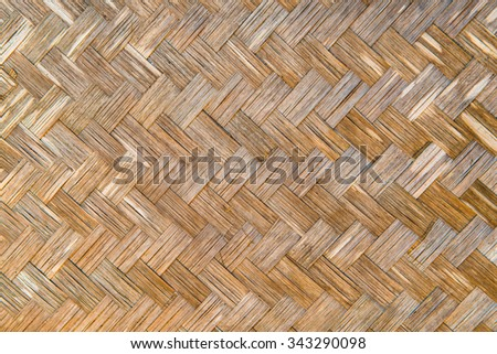 Background of woven bamboo wall, Thailand. - stock photo