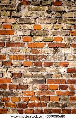 Background of yellow and red brick wall texture   - stock photo