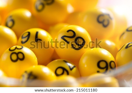 Background of yellow balls with bingo numbers used to randomly select lucky numbers during a bingo game - stock photo