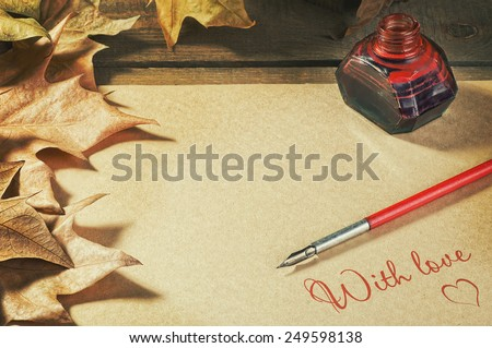 background old paper pen fountain, foliage, inks on a wooden table  letter of love, Valentine - stock photo