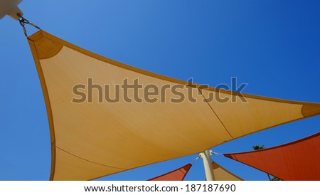 Background or texture: Canopies anchored to steel structures provide colorful shade at an outdoor pavilion. - stock photo