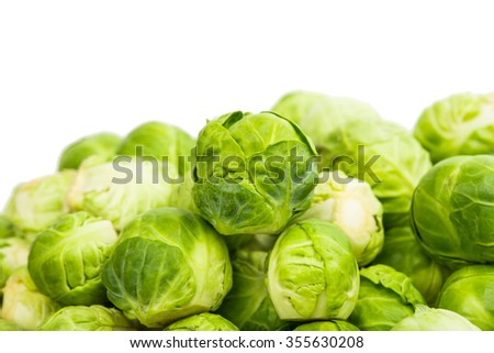 background or texture of fresh green Brussel Sprouts. - stock photo