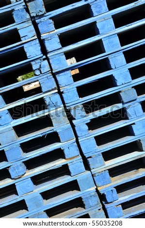 Background or Texture: Stacks of blue painted wooden pallets