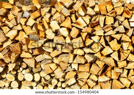 Background or texture symmetric with pieces of wood for stove fireplace - stock photo