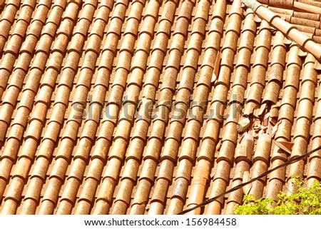 Background or texture symmetric with roof with hole in broken shingles - stock photo