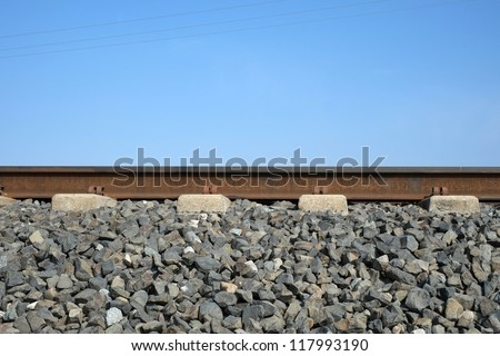 Background or texture: The roadbed consists of the gravel ballast and concrete ties topped by the actual steel rails - stock photo