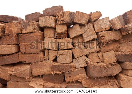Background pattern abstract of pile of drying stacked bog peat turf briquette cuttings