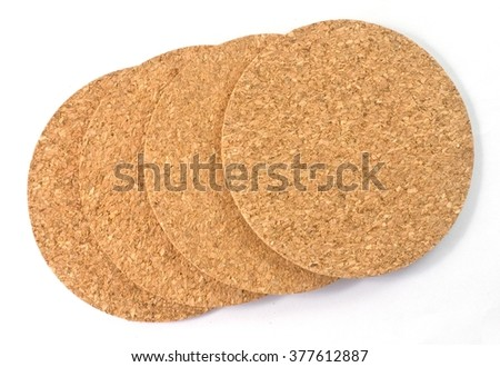 Background Pattern, Four Brown Round Cork Coasters Isolated on A White Background.