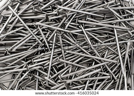Background pattern of stacked work nails. - stock photo