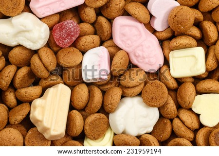 Background pepernoten and colorful sweets Sinterklaas. Typical food for Sinterklaas celebration on 5 december. Event in Holland, Netherlands and Belgium. - stock photo