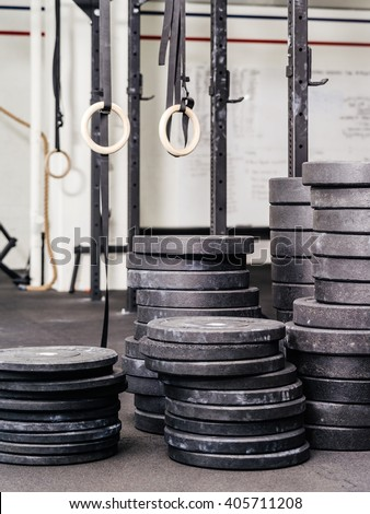 Background photo of stacks barbell weights or plates at a indoor gym. - stock photo