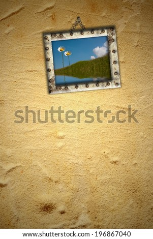 Background,picture hanging on the wall with idyllic romantic photo of two daisy, blank space for write text, greeting or invitation card
