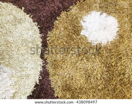 Background picture of a brown and white carpet