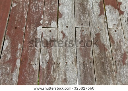 Background planks to put together a weathered wooden floor for a long time until molt decay. - stock photo