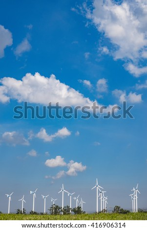 Background portrait poster for clean energy . Cloudy skies Bottom image A wind turbine farm