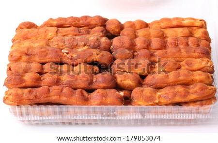 Background ripe tamarind fruit peeled. - stock photo
