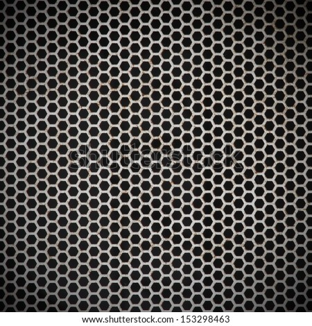 Background sheet of metal covered with lines of holes