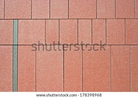 Background stone wall texture of red granite - stock photo