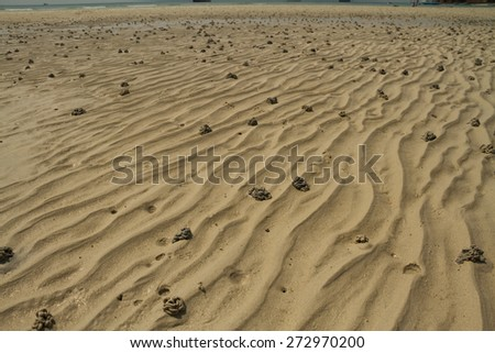 Background surface sand with traces of water flowing over the wave. - stock photo