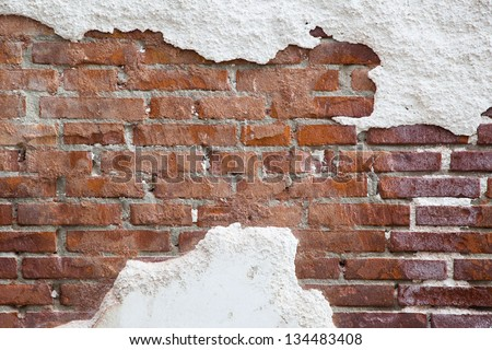 background texture from brick wall with cracked plaster - stock photo