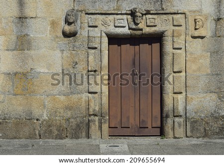 background texture granite facade with old wooden door - stock photo