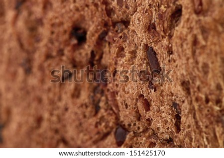 background texture of a porous brown bread