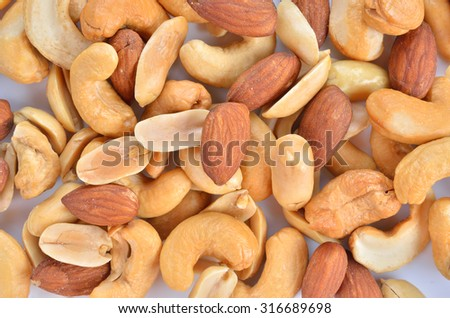 Background texture of assorted mixed nuts including cashew nu - stock photo