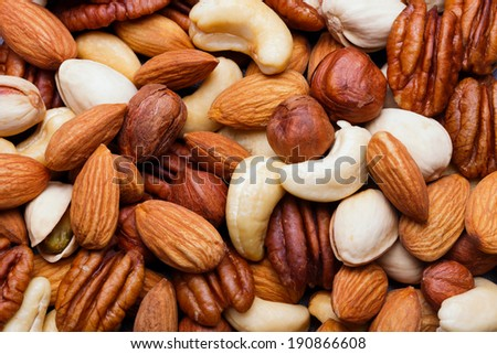 Background texture of assorted mixed nuts including cashew nuts, pecan nuts, almonds, - stock photo