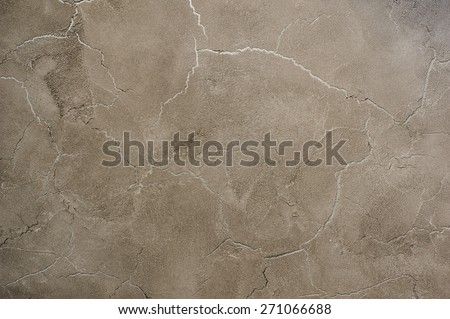 Background texture of beige gold plaster walls. - stock photo
