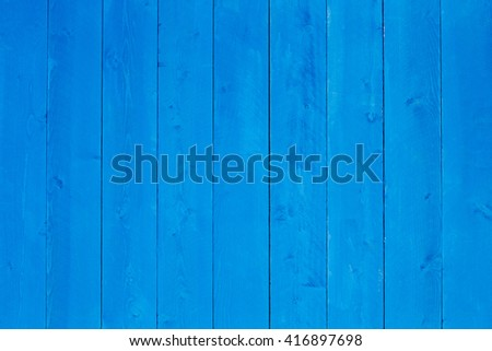 Background texture of blue stained wooden boards in an upright orientation with copy space in a creativity and decorating concept - stock photo
