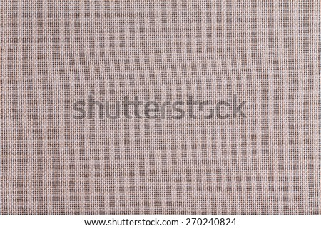 Background texture of coarse woven beige fabric with an open mesh weave of natural fibers in a full frame view - stock photo