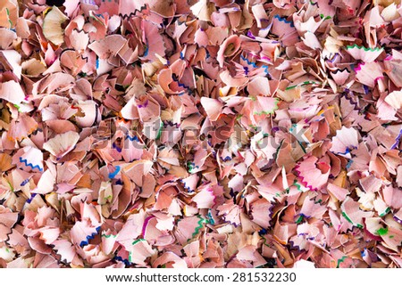Background texture of colorful wood shavings left behind when sharpening colored pencils crayons for art or school in a random full frame multicolored scatter - stock photo