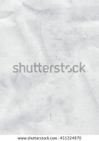 Background texture of creased off white paper with a crumpled surface in a full frame view with copy space - stock photo