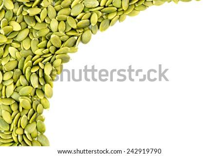 Background texture of fresh green pumpkin seeds - stock photo